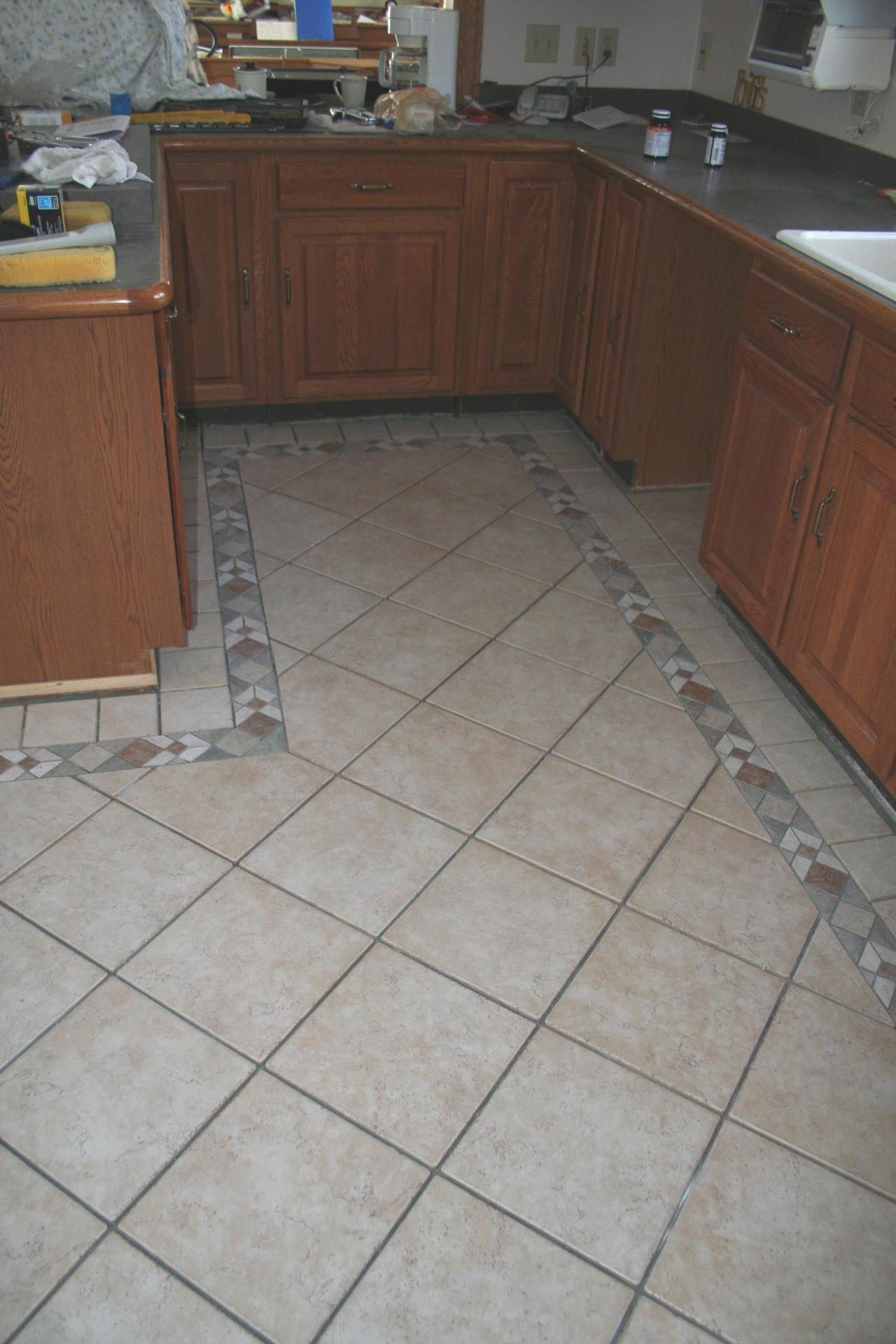 Nest homes construction kitchen heated tile floorremodeling natural looking stone tiles dailygadgetfo Images