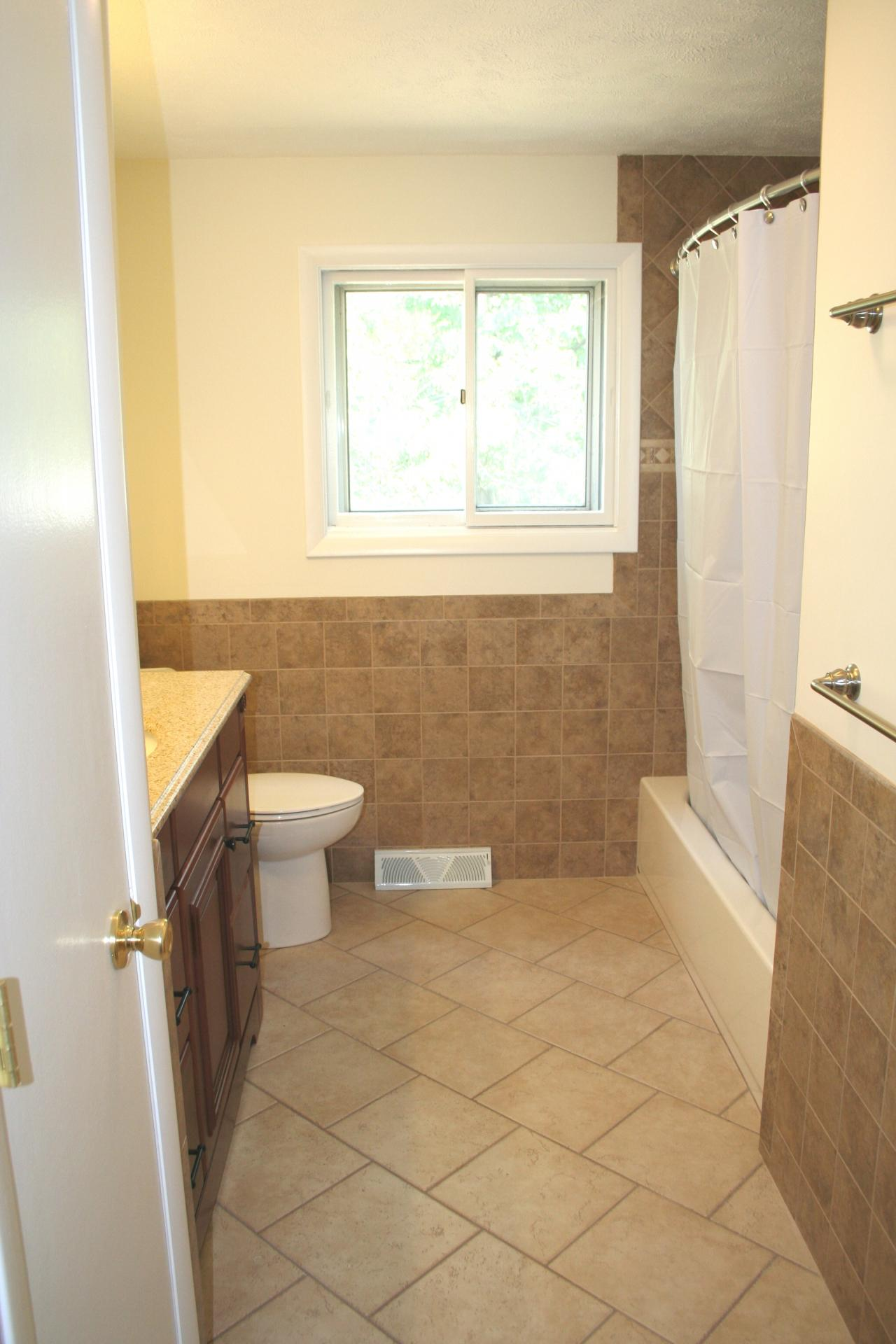 Mentor ohio bathroom with 12x12 inch diagonal floor and 6x6 wall tile